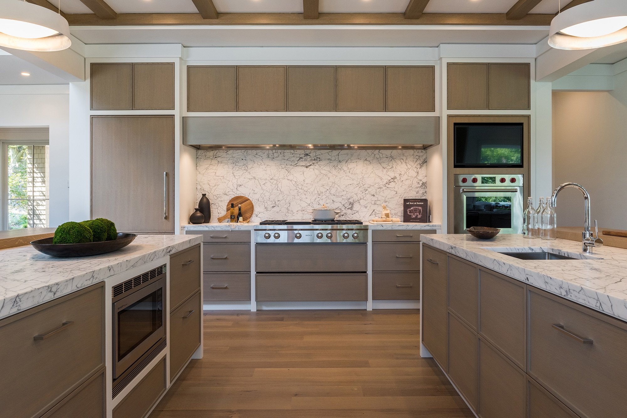 The HOBI Award-winning kitchen in Osprey, with custom cabinetry is superbly simple, yet remarkably functional.