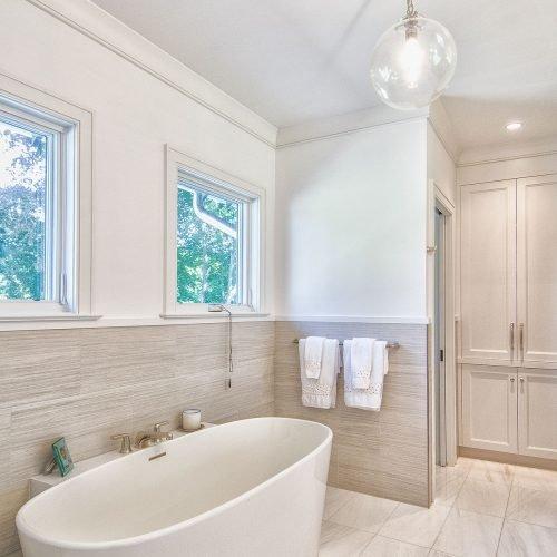 The master bath with large soaking tub and custom, herringbone inlaid tile.