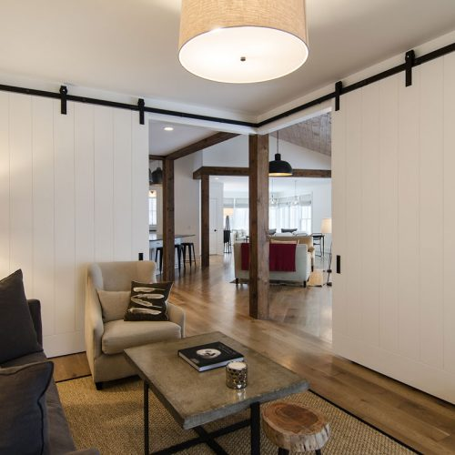 The study off the living area is cornered with sliding, barn doors for privacy.