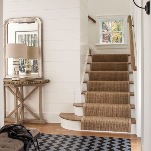 The entryway has a shiplap sided interior wall.