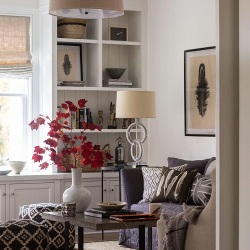 A view into the study with built-in bookshelves and cabinetry.