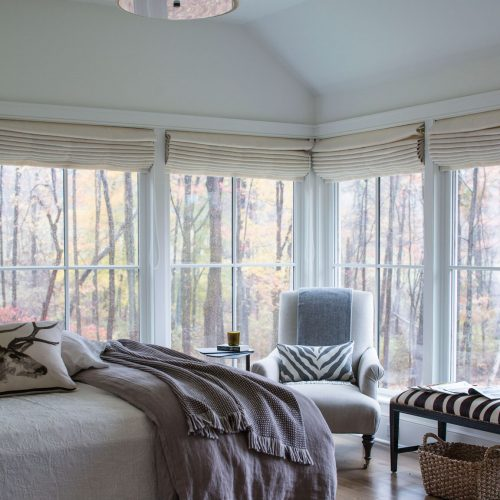 A segregated master suite and guestrooms provide privacy for both guests and homeowners.
