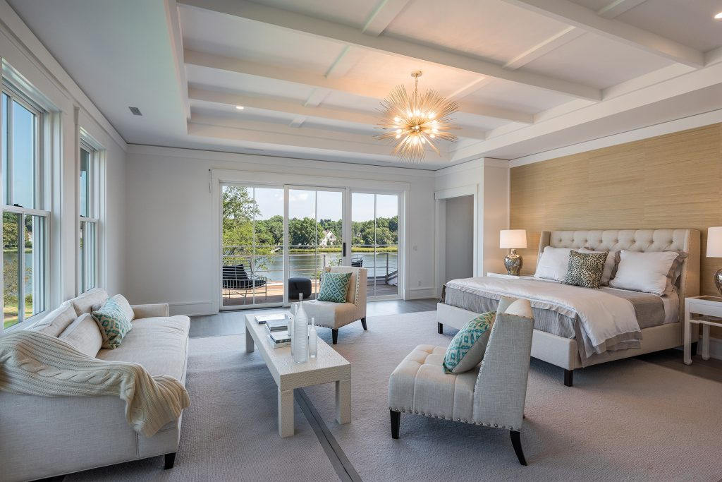 The master bedroom is designed feel like a hotel suite with multiple water views overlooking the backyard, pool, gardens and pond.